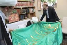 گزارش تصویری: اهدای پرچم بارگاه ملکوتی امیرالمؤمنین علیه السلام